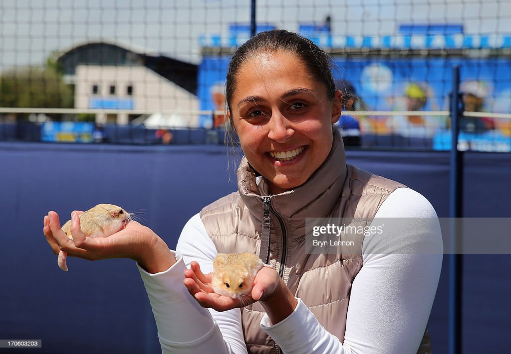 Defending Champion Tamira Paszek of Austria poses for a photo with two Fat Tailed Gerbils during day one of the Aegon International at Devonshire Park on June 15, 2013 in Eastbourne, England.