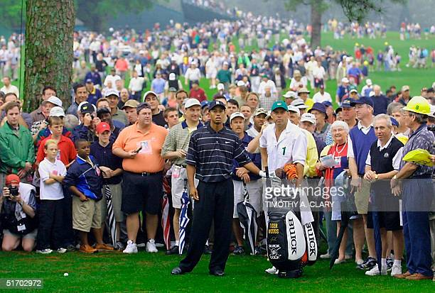 Defending champion Tiger Woods of the US sizes up his approach shot on the 8th fairway 10 April 2002 during his last practice round for the 2002...