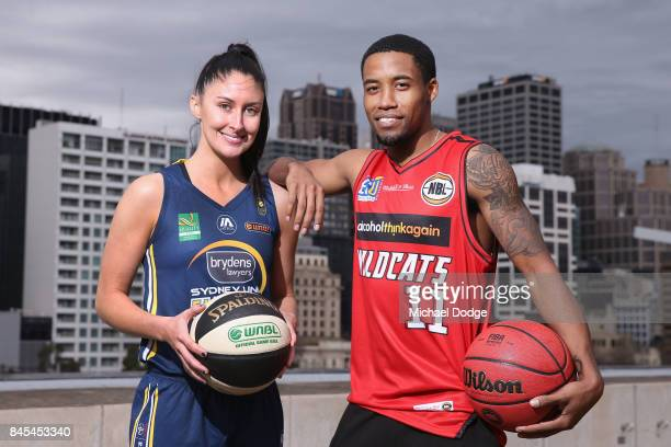 Defending champions KatieRae Ebzery Sydney Flames Bryce Cotton Perth Wildcats pose during the NRL Qualifying Final match between the Melbourne Storm...