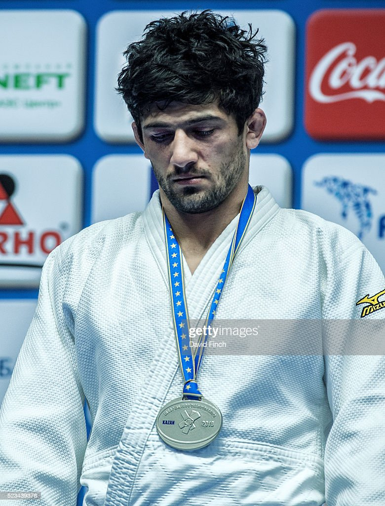 Defending European champion Lasha Shavdatuashvili of Georgia looks very disappointed during the u73kg medal ceremony after being disqualified in the...