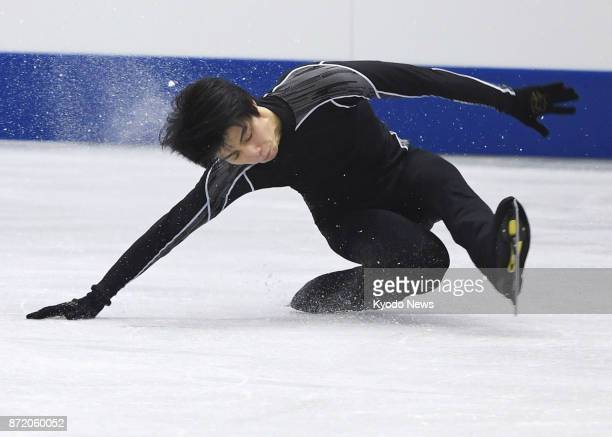 Defending world and Olympic champion Yuzuru Hanyu falls during training in Osaka on Nov 9 for the NHK Trophy with the spill bad enough for him to...