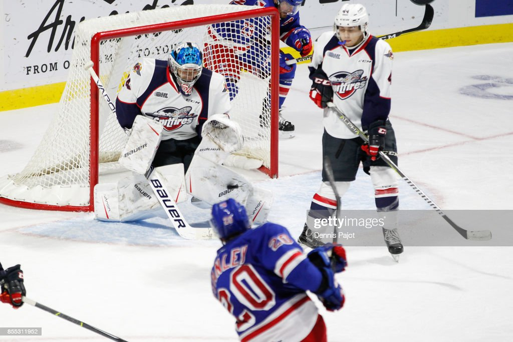 Defeneman Logan Stanley #20 of the Kitchener Rangers fires the puck against goaltender Michael DiPietro #64 of the Windsor Spitfires on September 28, 2017 at the WFCU Centre in Windsor, Ontario, Canada.