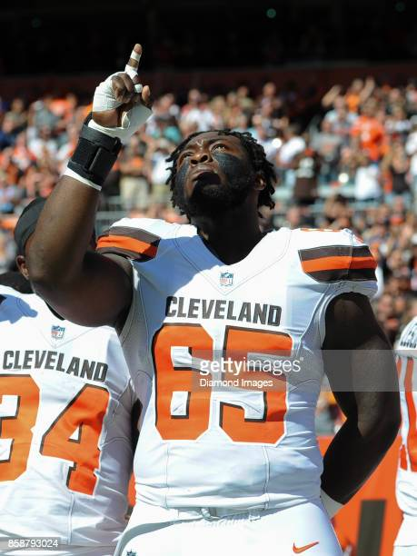Defenisve lineman of the Cleveland Browns gestures toward the sky as he stands for the National Anthem prior to a game on October 1 2017 against the...