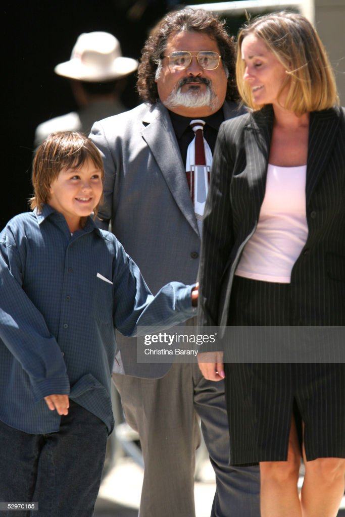 Defense 9-year old witness Prudence Brando (L), granddaughter of the late actor Marlon Brando, her mother Karen Brando (R) and Jesus Castillo (C) leave the Santa Barbara County Courthouse after a day of Michael Jackson's child molestation trial May 23, 2005 in Santa Maria, California. Jackson is charged in a 10-count indictment that included molesting a boy, plying him with liquor and conspiring to commit child abduction, false imprisonment and extortion. He has pleaded innocent.