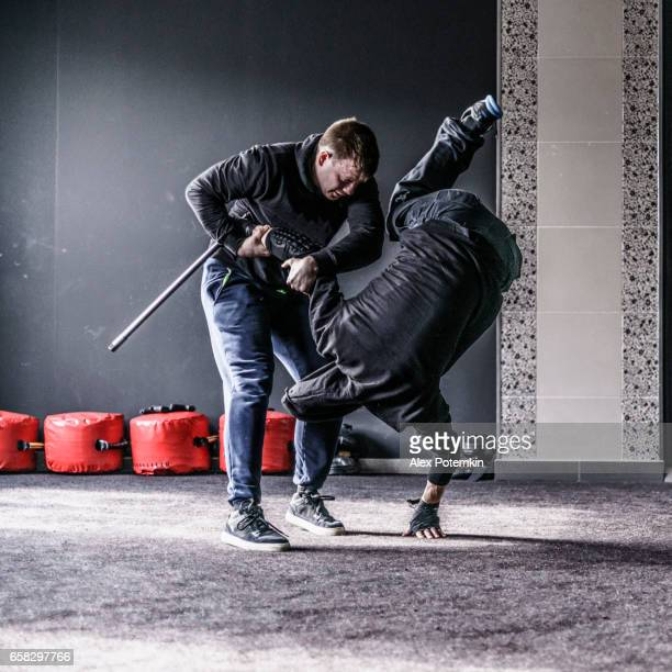 Defense against the attack with a bet. The sequence of the move. Krav Maga practice: the self-defense martial art developed for the Israel Army. Minsk, Belarus.