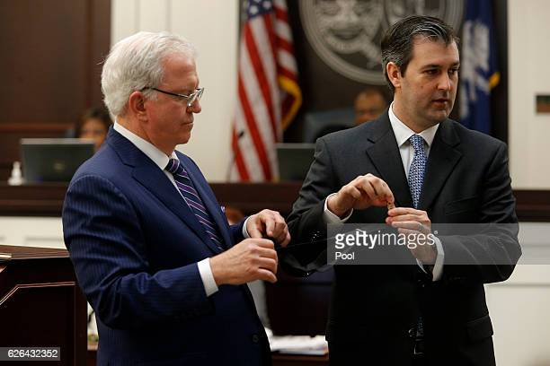 Defense attorney Andy Savage helps hold a item for former North Charleston police officer Michael Slager during his murder trial at the Charleston...