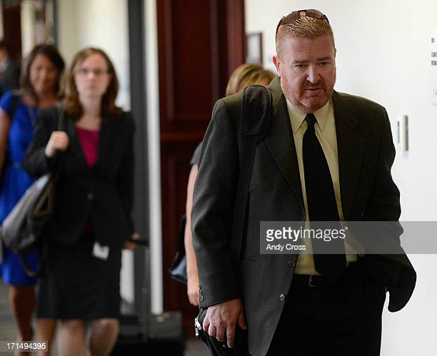 Defense attorney Daniel King leaves a status hearing for his client James Holmes at the Arapahoe County Justice Center Tuesday morning June 25 2013...