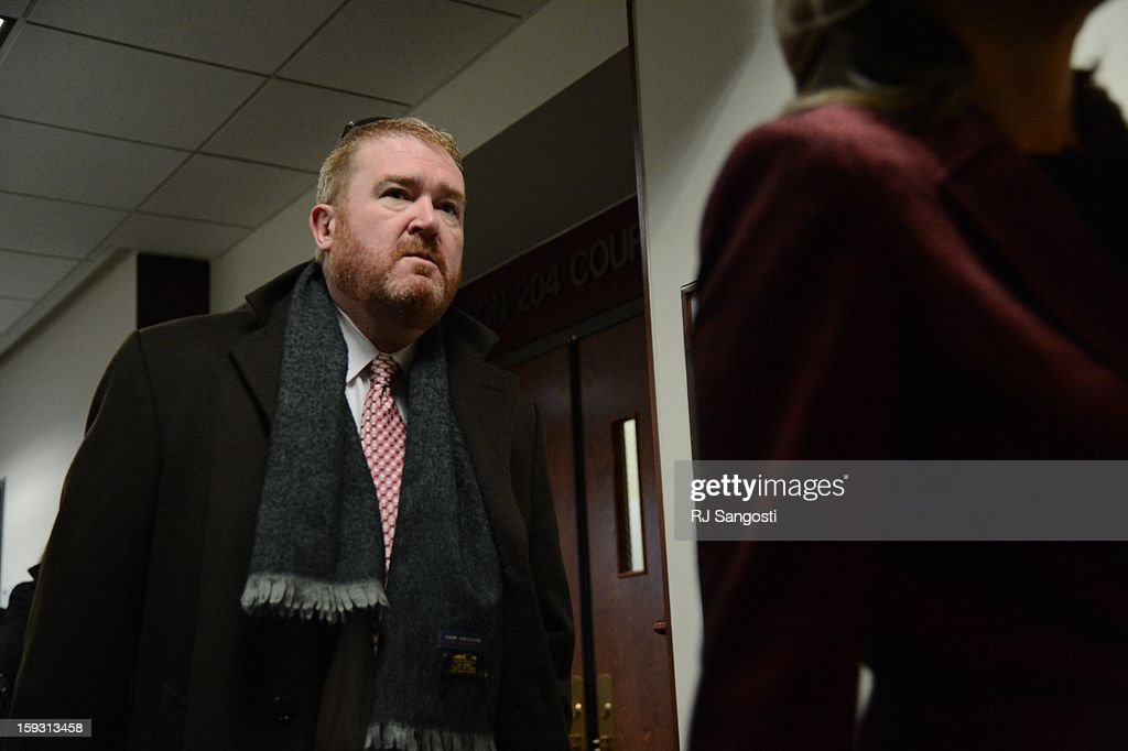 Defense attorney Daniel King leaves the courtroom, of the Arapahoe County Courthouse, Friday, January 11, 2013. The arraignment for Aurora theater shooting suspect James Holmes was postponed until March 2013 for the July 20 shooting at the Century 16 theater that killed 12 people and injured 70 others.