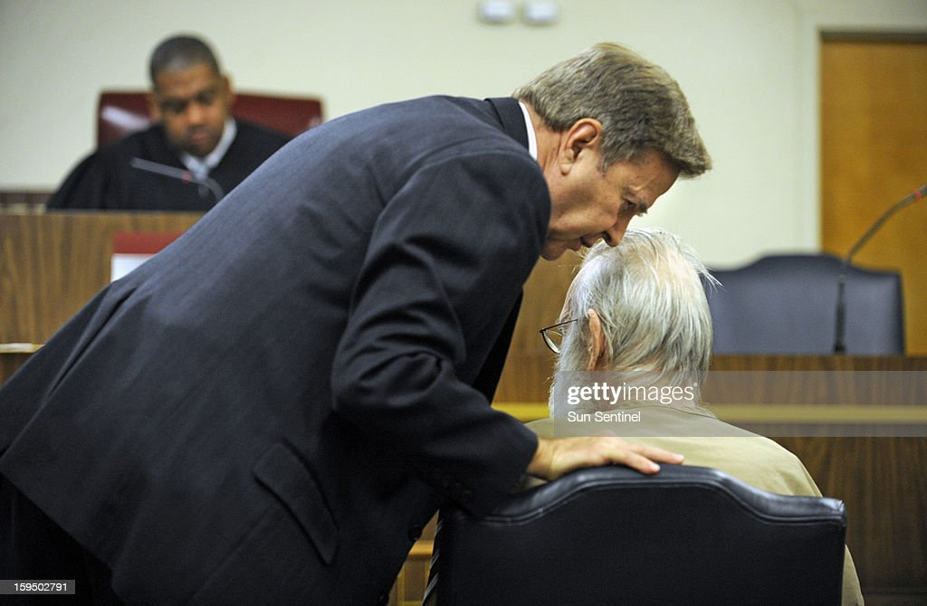 Defense attorney David Bogenschutz, foreground left, speaks to his client, retired priest Neil Doherty, 69, during his appearance at Broward County court, Monday, January 14, 2013, in Fort Lauderdale, Florida. Doherty, one of South Florida's most notorious priests, accused by several men of sexually abusing them in their youth, will go to prison for 12 to 15 years under the terms of a plea bargain he accepted.