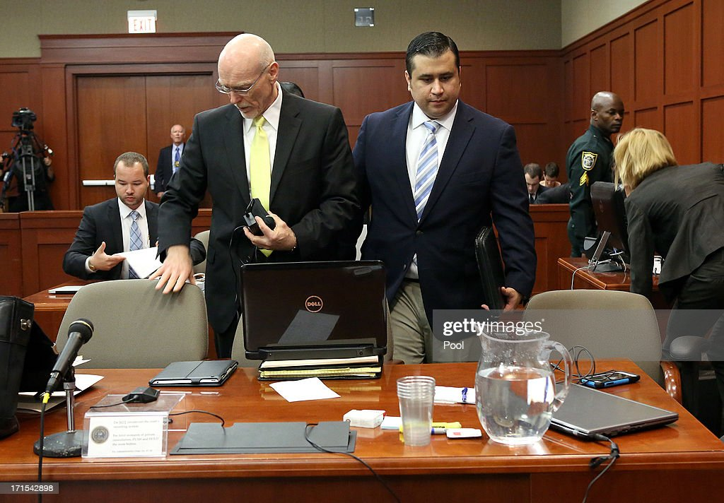 Defense attorney Don West (2nd L) and George Zimmerman (C) arrive during day 13 of Zimmerman's murder trial in Seminole circuit court June 26, 2013 in Sanford, Florida. Zimmerman is charged with second-degree murder for the February 2012 shooting death of 17-year-old Trayvon Martin.