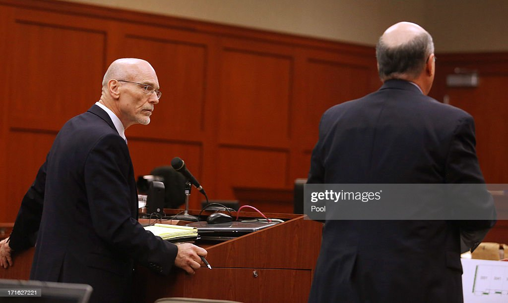 Defense attorney Don West looks at Assistant State Attorney Bernie de la Rionda after de la Rionda objected during Zimmerman's murder trial in Seminole circuit court June 27, 2013 in Sanford, Florida. Zimmerman is charged with second-degree murder for the February 2012 shooting death of 17-year-old Trayvon Martin.