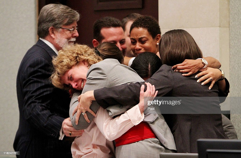 Defense attorney Dorothy Clay Sims, in gray jacket, hugs her client <a gi-track='captionPersonalityLinkClicked' href=/galleries/search?phrase=Casey+Anthony&family=editorial&specificpeople=7188333 ng-click='$event.stopPropagation()'>Casey Anthony</a>, along with the rest of the defense team after Anthony was acquitted of murder charges at the Orange County Courthouse on July 5, 2011 in Orlando, Florida. <a gi-track='captionPersonalityLinkClicked' href=/galleries/search?phrase=Casey+Anthony&family=editorial&specificpeople=7188333 ng-click='$event.stopPropagation()'>Casey Anthony</a> had been accused of murdering her two-year-old daughter Caylee in 2008 and was found not guilty of manslaughter in the first degree.