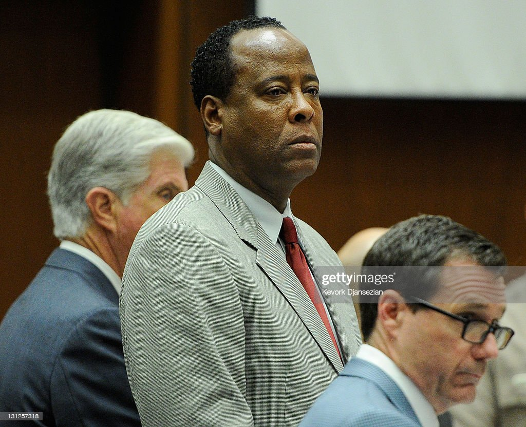 Defense attorney J. Michael Flanagan, Dr. <a gi-track='captionPersonalityLinkClicked' href=/galleries/search?phrase=Conrad+Murray&family=editorial&specificpeople=5945898 ng-click='$event.stopPropagation()'>Conrad Murray</a> and defense attorney <a gi-track='captionPersonalityLinkClicked' href=/galleries/search?phrase=Ed+Chernoff&family=editorial&specificpeople=6729855 ng-click='$event.stopPropagation()'>Ed Chernoff</a> look on prior to the start of the morning's court proceedings during the final stage of <a gi-track='captionPersonalityLinkClicked' href=/galleries/search?phrase=Conrad+Murray&family=editorial&specificpeople=5945898 ng-click='$event.stopPropagation()'>Conrad Murray</a>'s defense in his involuntary manslaughter trial in the death of singer Michael Jackson at the Los Angeles Superior Court on November 3, 2011 in Los Angeles, California. Murray has pleaded not guilty and faces four years in prison and the loss of his medical licenses if convicted of involuntary manslaughter in Jackson's death.