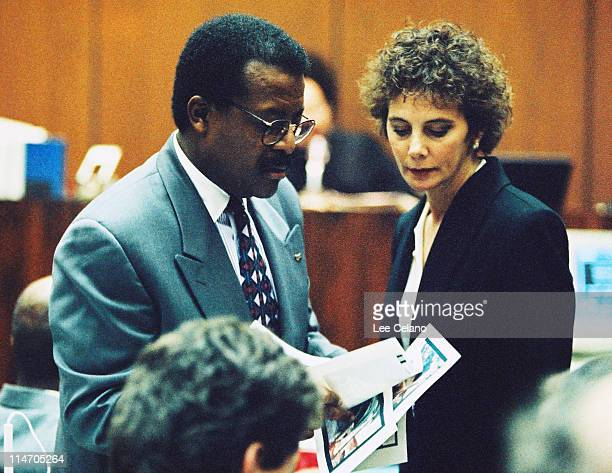 Defense attorney Johnnie Cochran confers with prosecutor Marcia Clark over graphic crime scene photos during testimony in the OJ Simpson Criminal...