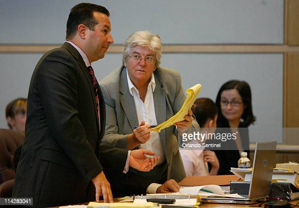 Defense attorney Jose Baez left and defense consultant Ann Finnell review their notes during jury selection for Casey Anthony trial at the Pinellas...