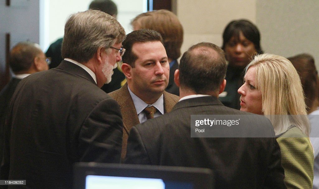 Defense attorney Jose Baez (C) talks with other attorneys after the end of the sentencing hearing for his client Casey Anthony on charges of lying to a law enforcement officer at the Orange County Courthouse July 7, 2011 in Orlando, Florida. Anthony was acquitted of murder charges on July 5, 2011 but will serve four, one-year sentences on her conviction of lying to a law enforcement officer. She will be credited for the nearly three-years of time served and good behavior and will be released July 13.