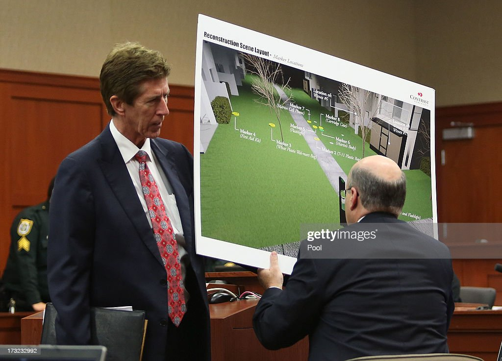 Defense attorney Mark O'Mara (L) and assistant state attorney Bernie de la Rionda (R) review evidence to be submitted to the court during a recess in George Zimmerman's murder trial in Semimole circuit court July 10, 2013 in Sanford, Florida. Zimmerman has been charged with second-degree murder for the 2012 shooting death of Trayvon Martin.