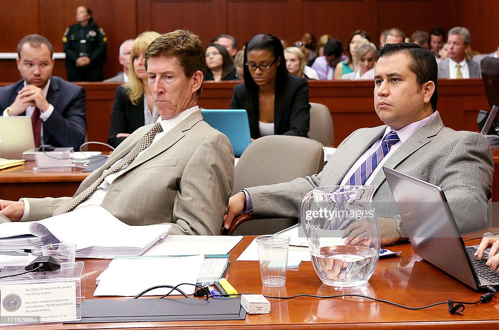 Defense attorney Mark O'Mara (C) and George Zimmerman listen during Zimmerman's murder trial in Seminole circuit court June 27, 2013 in Sanford, Florida. Zimmerman is charged with second-degree murder for the February 2012 shooting death of 17-year-old Trayvon Martin.