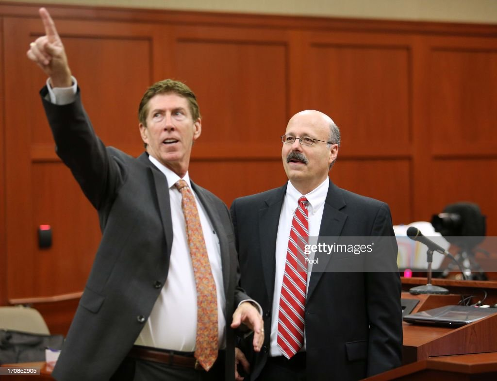 Defense attorney Mark O'Mara (L) and prosecutor Bernie de la Rionda discuss the courtroom layout for the next phase of jury selection in the George Zimmerman trial on the eighth day of his trial in Seminole circuit court June 19, 2013 in Sanford, Florida. Zimmerman is charged with second-degree murder for the February 2012 shooting death of 17-year-old Trayvon Martin.
