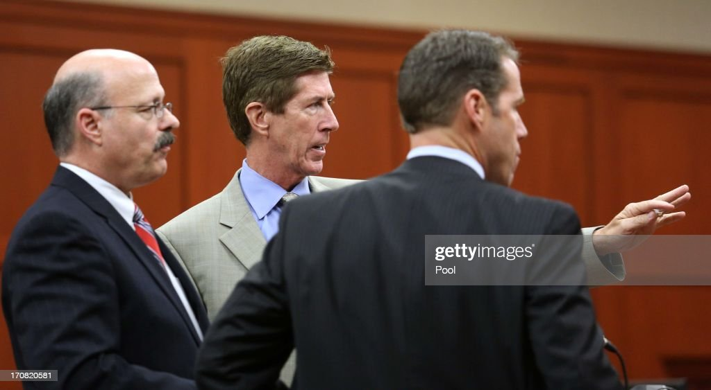 Defense attorney Mark O'Mara (center) discusses the layout of the courtroom with prosecutors Bernie de la Rionda (left) and John Guy, after the judge announced the jury pool had reach 40 in Seminole circuit court on the 7th day of Zimmerman's trial June 18, 2013 in Sanford, Florida. Zimmerman is charged with second-degree murder for the February 2012 shooting death of 17-year-old Trayvon Martin.