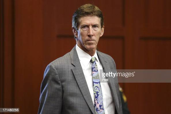 Defense attorney Mark O'Mara enters the courtroom for George Zimmerman's trial in Seminole circuit court June 25 2013 in Sanford Florida Zimmerman is...