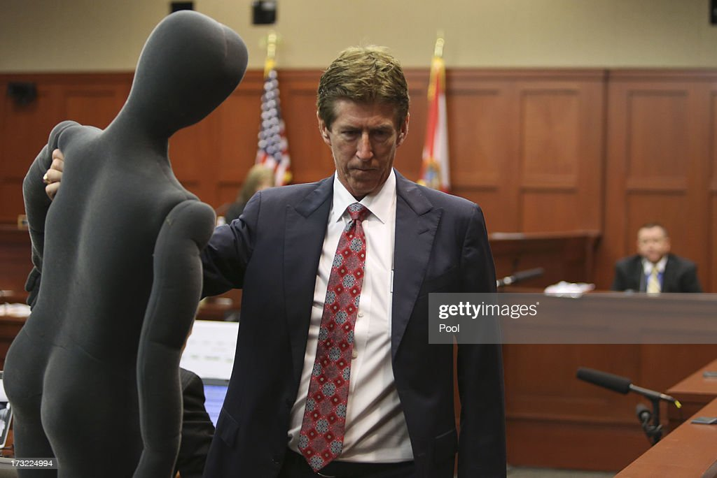 Defense attorney Mark O'Mara (L) holds a foam dummy used to describe the altercation between George Zimmerman and Trayvon Martin to defense witness and law enforcement expert Dennis Root (R) during Zimmerman's murder trial in Semimole circuit court July 10, 2013 in Sanford, Florida. Zimmerman has been charged with second-degree murder for the 2012 shooting death of Trayvon Martin.