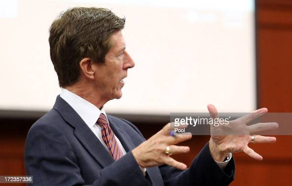 Defense attorney Mark O'Mara questions Sanford police officer Chris Serino during the George Zimmerman trial in Seminole circuit court July 2 2013 in...