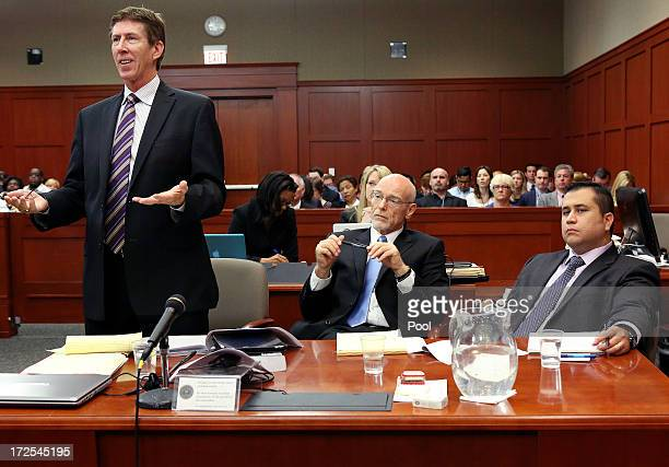 Defense attorney Mark O'Mara speaks to the judge while defense attorney Don West and George Zimmerman listen during the George Zimmerman trial in...