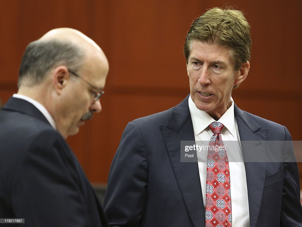 Defense attorney Mark O'Mara speaks with assistant state attorney Bernie de la Rionda during George Zimmerman's murder trial in Semimole circuit court July 10, 2013 in Sanford, Florida. Zimmerman has been charged with second-degree murder for the 2012 shooting death of Trayvon Martin.
