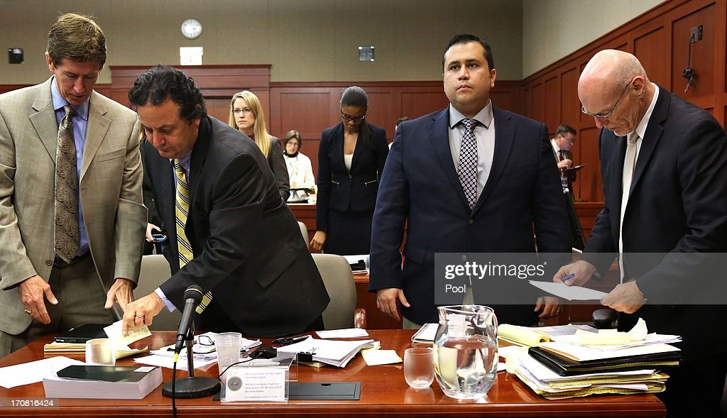 Defense attorney Mark O'Mara, with jury consultant Robert Hirschhorn, defendant George Zimmerman and co-counsel Don West, stand during an arrival of the judge in the courtroom in Seminole circuit court on the 7th day of his trial June 18, 2013 in Sanford, Florida. Zimmerman is charged with second-degree murder for the February 2012 shooting death of 17-year-old Trayvon Martin.
