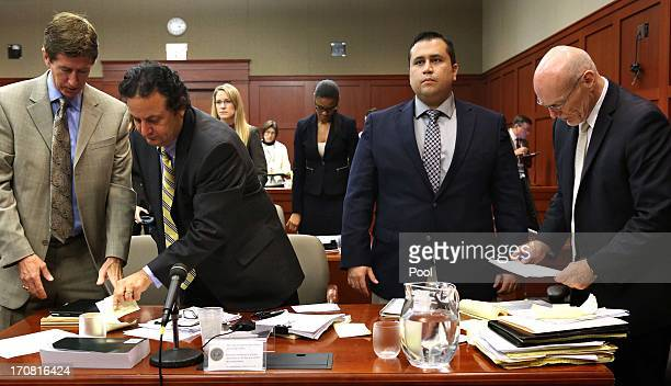Defense attorney Mark O'Mara with jury consultant Robert Hirschhorn defendant George Zimmerman and cocounsel Don West stand during an arrival of the...