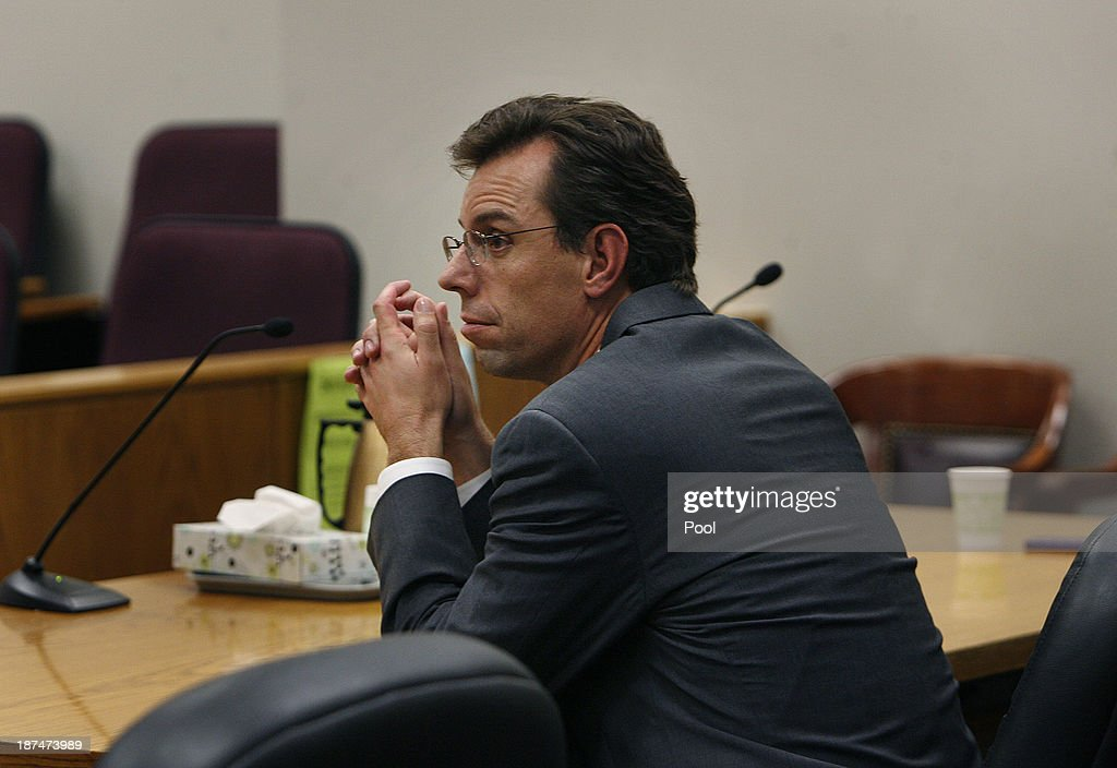 Defense attorney Randy Spencer waits for the judge to arrive in court for the reading of the verdict for Martin MacNieill for the murder of his wife Michele MacNeill on November 9, 2013 in Provo, Utah. Martin MacNeill, was found guilty of murdering his wife Michele MacNeill in 2007 to continue an affair with a younger woman.