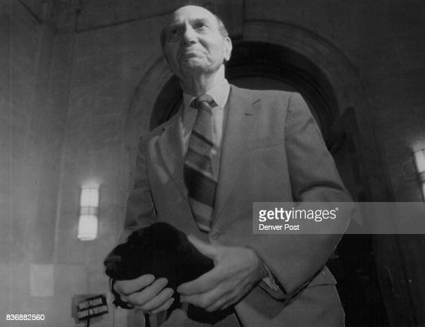 Defense attorney Walter Gerash waits for James King in the hall of the City and County Building Gerash holds a black Denver Chess Club Tshirt to give...