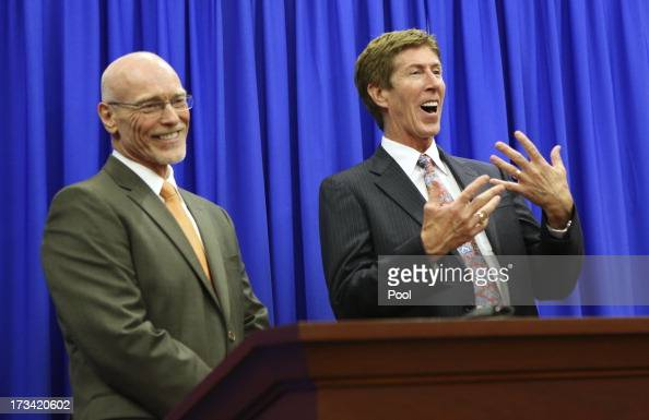 Defense attorneys Don West and Mark O'Mara address the media after a jury found George Zimmerman not guilty in Seminole circuit court July 13 2013 in...