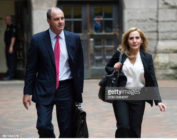 Defense attorneys for Bill Cosby Brian McMonagle and Angela Agrusa leave the Allegheny County Courthouse May 23 2017 in Pittsburgh Pennsylvania Jury...