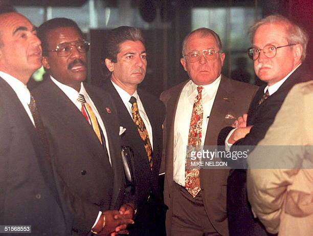 Defense attorneys for O J Simpson wait for an elevator in the Criminal Courts Building in Los Angeles 05 January before the start of hearings on...