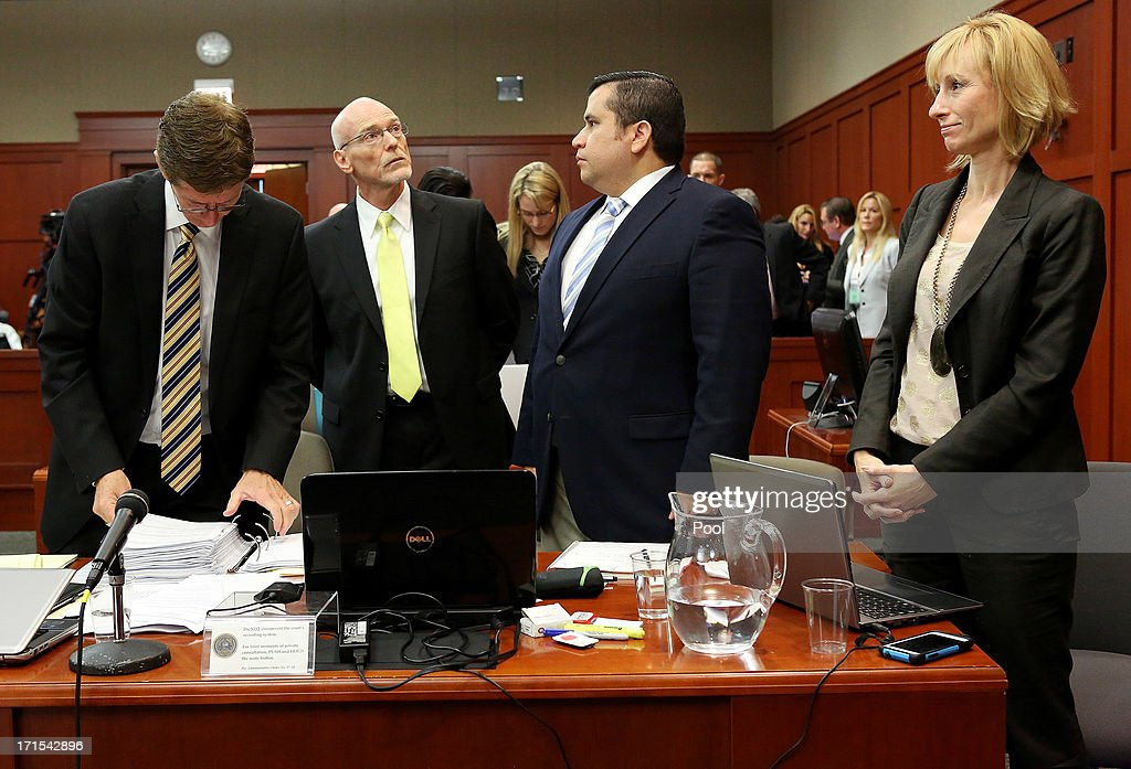 Defense attorneys (L to R) Mark O'Mara, Don West, George Zimmerman and defense attorneys Lorna Truett stand at the start of day 13 of Zimmerman's murder trial in Seminole circuit court June 26, 2013 in Sanford, Florida. Zimmerman is charged with second-degree murder for the February 2012 shooting death of 17-year-old Trayvon Martin.