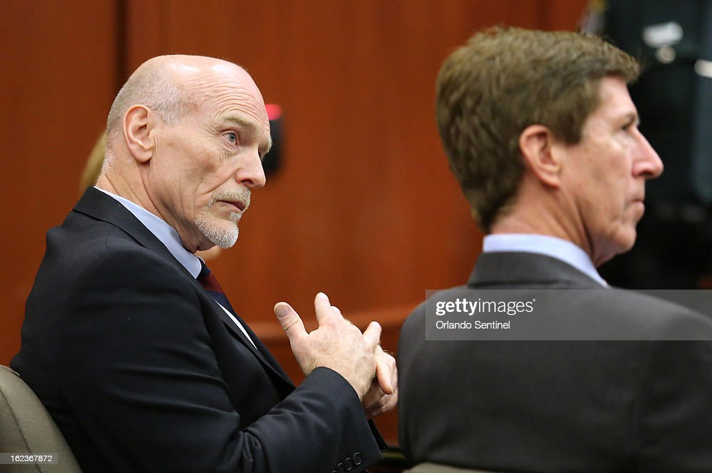 Defense attorneys Mark O'Mara, right, and Don West listen to Assistant State Attorney Bernie de la Rionda, as attorneys for the state and George Zimmerman argue whether the attorney for Trayvon Martin's parents, Benjamin Crump, should be required to give a deposition for the defense, during a hearing in Seminole circuit court in Sanford, Florida, Friday, February 22, 2013.