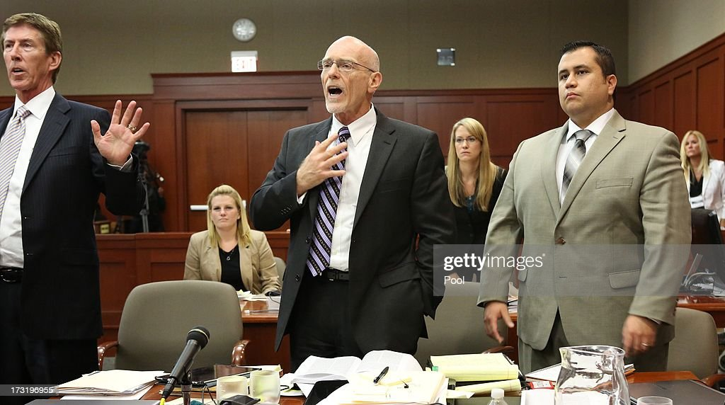 Defense counsel Don West (C) and Mark O'Mara try to get Judge Debra Nelson's attention as she abruptly leaves the bench, with George Zimmerman looking on, in the courtroom July 9, 2013 in Sanford, Florida. Zimmerman has been charged with second-degree murder for the 2012 shooting death of Trayvon Martin.