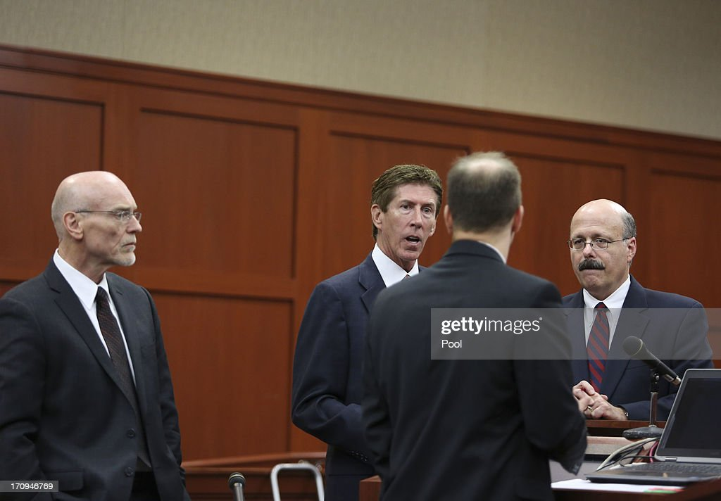 Defense counsel Don West (L), Mark O'Mara (C), and assistant state attorneys Richard Mantei (Center R), and Bernie de la Rionda discuss evidence for and against potential jurors during the final stages of jury selection in George Zimmerman's trial in Seminole circuit court June 20, 2013 in Sanford, Florida. Zimmerman is charged with second-degree murder for the February 2012 shooting death of 17-year-old Trayvon Martin.