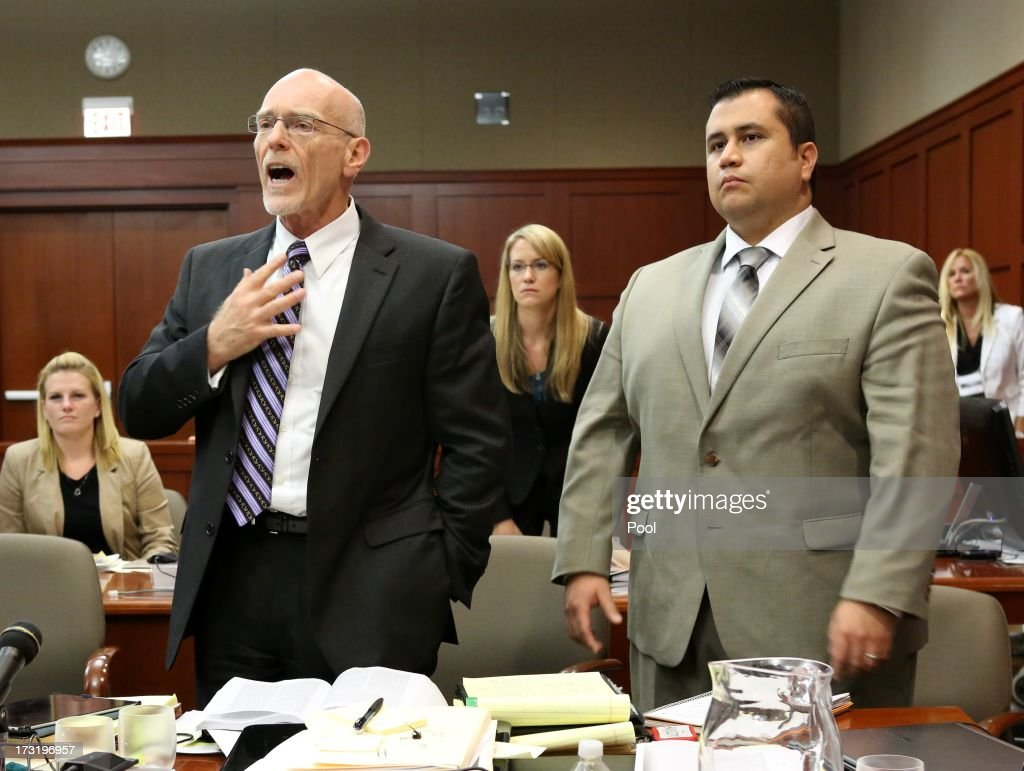 Defense counsel Don West (L) tries to Judge Debra Nelson's attention as she abruptly leaves the bench, with George Zimmerman looking on, in the courtroom July 9, 2013 in Sanford, Florida. Zimmerman has been charged with second-degree murder for the 2012 shooting death of Trayvon Martin.