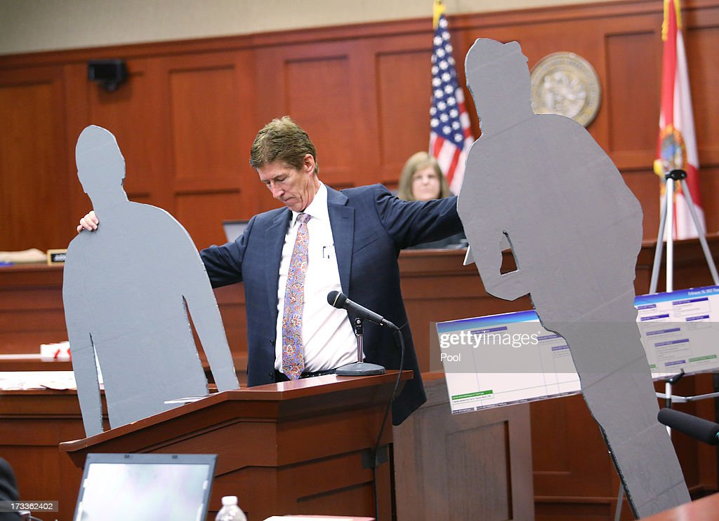 Defense counsel Mark O'Mara carries lifesize cutouts representing George Zimmerman and Trayvon Martin during closing arguments for the defence in...