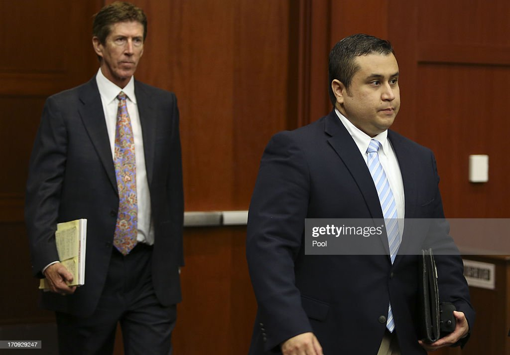 Defense counsel Mark O'Mara (L) follows his client and defendant, George Zimmerman, into the courtroom folloiwng a brief recess in his trial in Seminole circuit court June 20, 2013 in Sanford, Florida. Zimmerman is charged with second-degree murder for the February 2012 shooting death of 17-year-old Trayvon Martin.