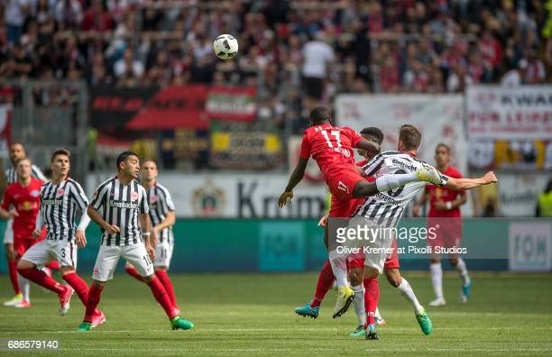 Defense Dayot Upamecano of RB Leipzig at a headball while beinmg interfered by Forward Haris Seferovic of Eintracht Frankfurt at the Commerzbank...