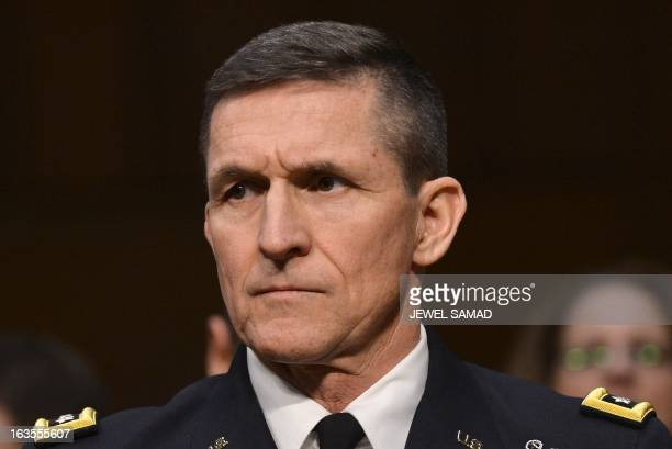 Defense Intelligence Agency Director Lt Gen Michael Flynn testifies before a full committee hearing on 'Current and Projected National Security...