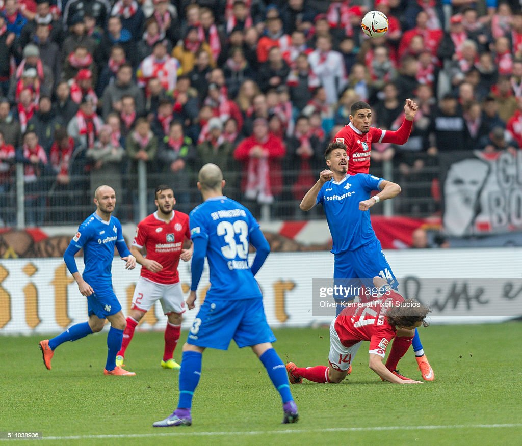 Defense <a gi-track='captionPersonalityLinkClicked' href=/galleries/search?phrase=Leon+Balogun&family=editorial&specificpeople=5443646 ng-click='$event.stopPropagation()'>Leon Balogun</a> (3) of FSV Mainz 05 and Midfielder <a gi-track='captionPersonalityLinkClicked' href=/galleries/search?phrase=Julian+Baumgartlinger&family=editorial&specificpeople=4228877 ng-click='$event.stopPropagation()'>Julian Baumgartlinger</a> (14) of FSV Mainz 05 defending the ball against <a gi-track='captionPersonalityLinkClicked' href=/galleries/search?phrase=Sandro+Wagner&family=editorial&specificpeople=595390 ng-click='$event.stopPropagation()'>Sandro Wagner</a> (14) of SV Darmstadt 98 at Coface Arena on March 06, 2016 in Mainz, Germany.
