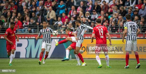 Defense Michael Hector of Eintracht Frankfurt and Forward Yussuf Yurary Poulsen of RB Leipzig fighting for the ball at the Commerzbank Arena during...