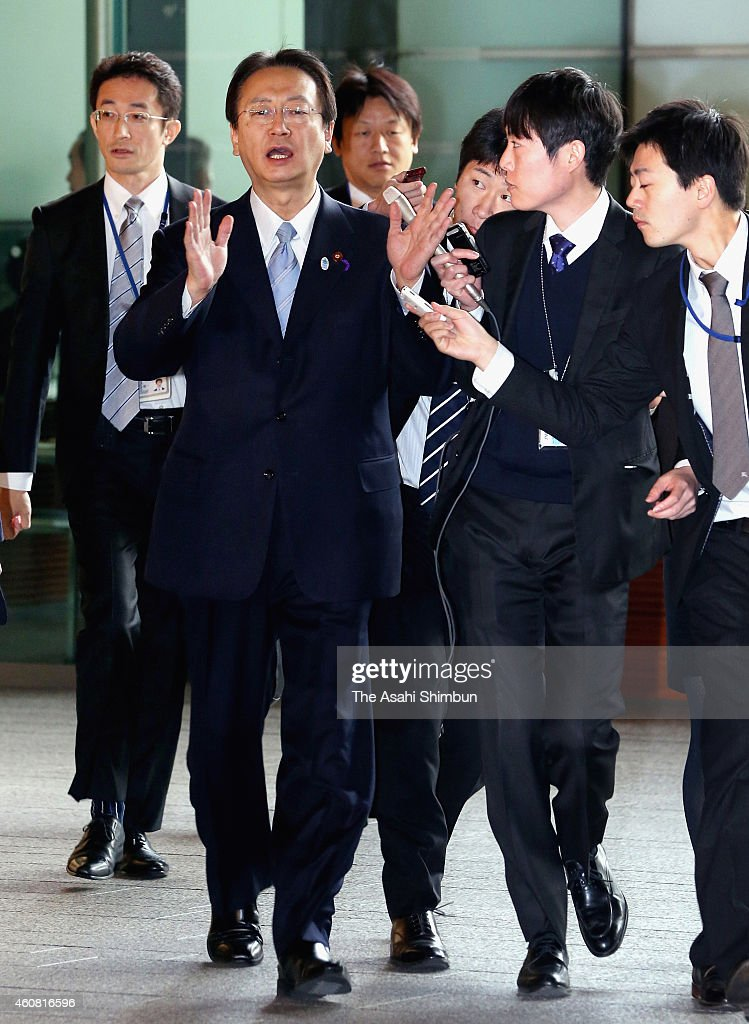 Defense Minister <a gi-track='captionPersonalityLinkClicked' href=/galleries/search?phrase=Akinori+Eto&family=editorial&specificpeople=5129797 ng-click='$event.stopPropagation()'>Akinori Eto</a> speaks to media reporters on arrival at Prime Minister <a gi-track='captionPersonalityLinkClicked' href=/galleries/search?phrase=Shinzo+Abe&family=editorial&specificpeople=559017 ng-click='$event.stopPropagation()'>Shinzo Abe</a>'s official residence to attend a cabinet meeting on December 24, 2014 in Tokyo, Japan. Easily re-elected Prime Minister <a gi-track='captionPersonalityLinkClicked' href=/galleries/search?phrase=Shinzo+Abe&family=editorial&specificpeople=559017 ng-click='$event.stopPropagation()'>Shinzo Abe</a> named Gen Nakatani to replace scandal-tainted <a gi-track='captionPersonalityLinkClicked' href=/galleries/search?phrase=Akinori+Eto&family=editorial&specificpeople=5129797 ng-click='$event.stopPropagation()'>Akinori Eto</a> as defense minister, the only change in the Cabinet following the ruling party's Lower House election victory on December 14. The special Diet session will close on Dec. 26 because its main business is to formally choose the prime minister.