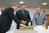 Defense Minister Franz Josef Jung and Wolfgang Schneiderhan general inspector of the German army look on as architect Andreas Meck explains the...