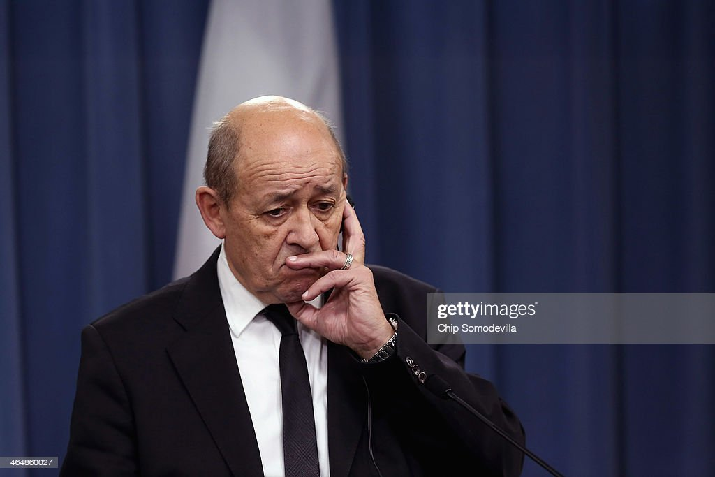 Defense Minister <a gi-track='captionPersonalityLinkClicked' href=/galleries/search?phrase=Jean-Yves+Le+Drian&family=editorial&specificpeople=2122785 ng-click='$event.stopPropagation()'>Jean-Yves Le Drian</a> listens to reporters' questions during a news conference with U.S. Defense Secretary Chuck Hagel at the Pentagon January 24, 2014 in Arlington, Virginia. The two leaders talked about their military cooperation in Africa and other topics during their meetings.